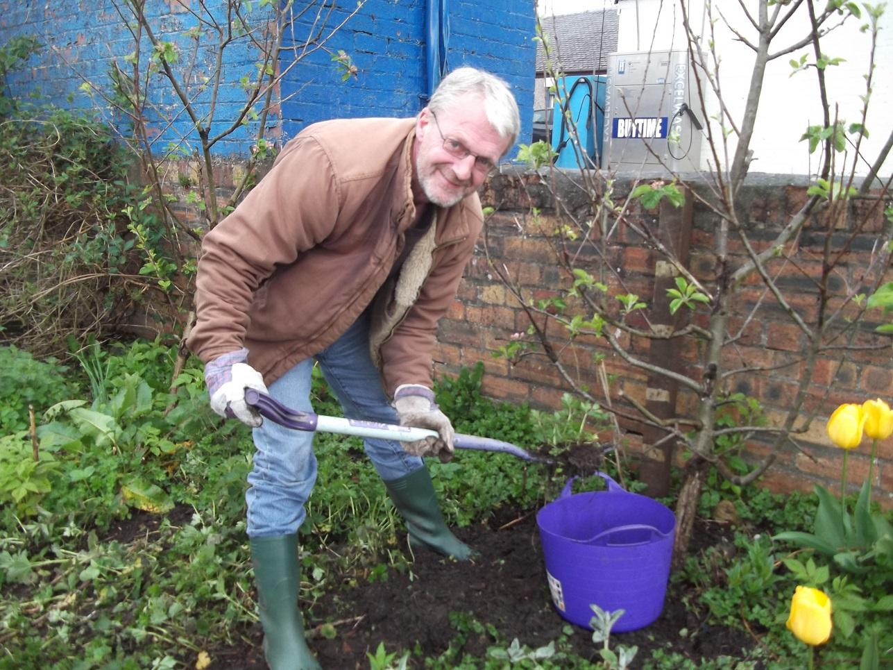 CEI volunteer Robert working hard to maintain the New Cumnock Community Wildlife Garden